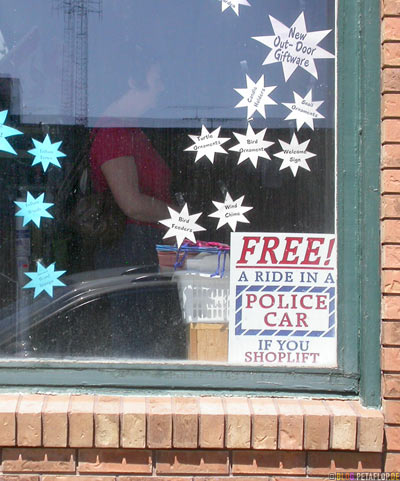 Free-A-ride-in-a-police-car-if-you-shoplift-Shop-Window-Schaufenster-Langenburg-Saskatchewan-Canada-Kanada-DSCN8745.jpg