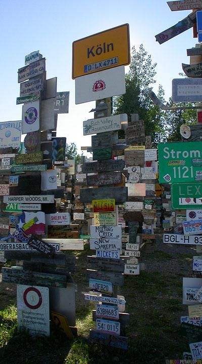 Koeln-Duesseldorf-Signpost-Forest-Schilderwald-Alaska-Highway-Watson-Lake-Yukon-Canada-Kanada-DSCN0381.jpg