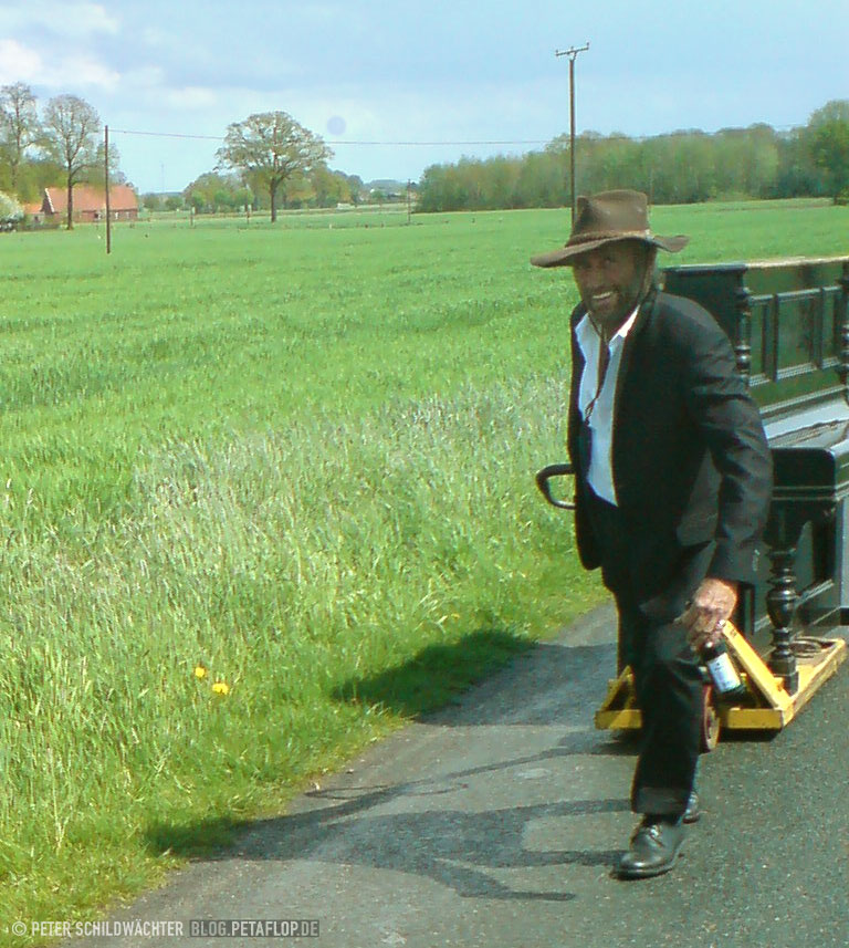 Man pulling Piano, Münsterland, Germany, May Tour